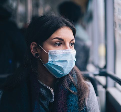 woman public transportation wearing mask during covid-19 pandemic