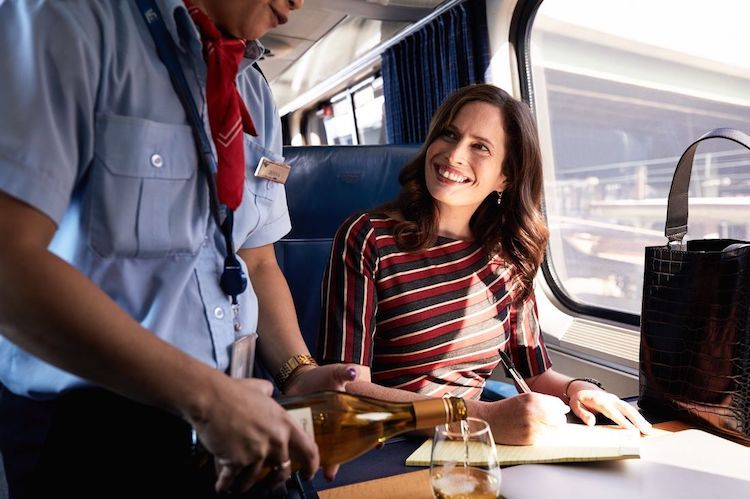 Passenger receiving customer service on Amtrak