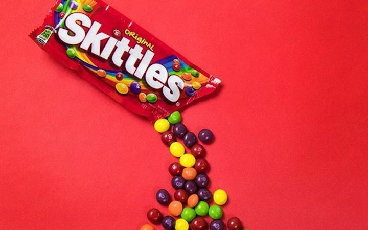 skittles candy pouring out of package